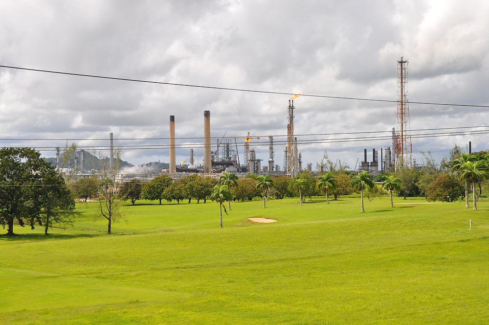 Appearances can be deceiving: Behind the smokestacks of Trinidad's state-run oil refinery is a 25-hectare nature sanctuary. Photo: Meg Pier