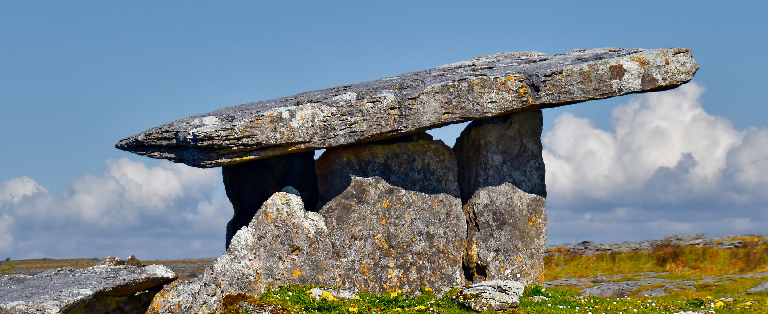"""Poulnabrone dolmen in Irish means """"hole of the quern stones"""" and is located in the Burren, County Clare. It's one of about 172 portal tomb in Ireland. Photo: Ron Cogswell, Creative Commons"""