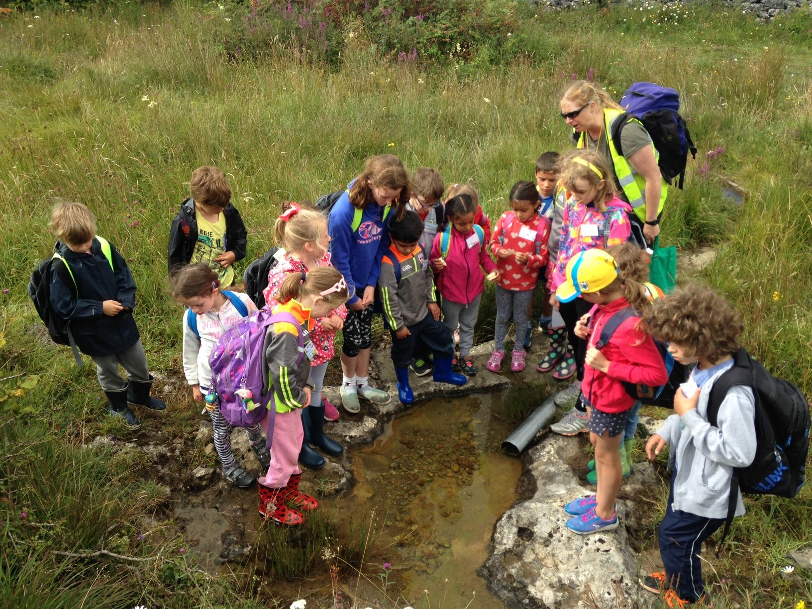 Learning Landscape Symposium contributor Kate Lavender taking children on an interactive day in the Burren. Photo: Burrenbeo Trust