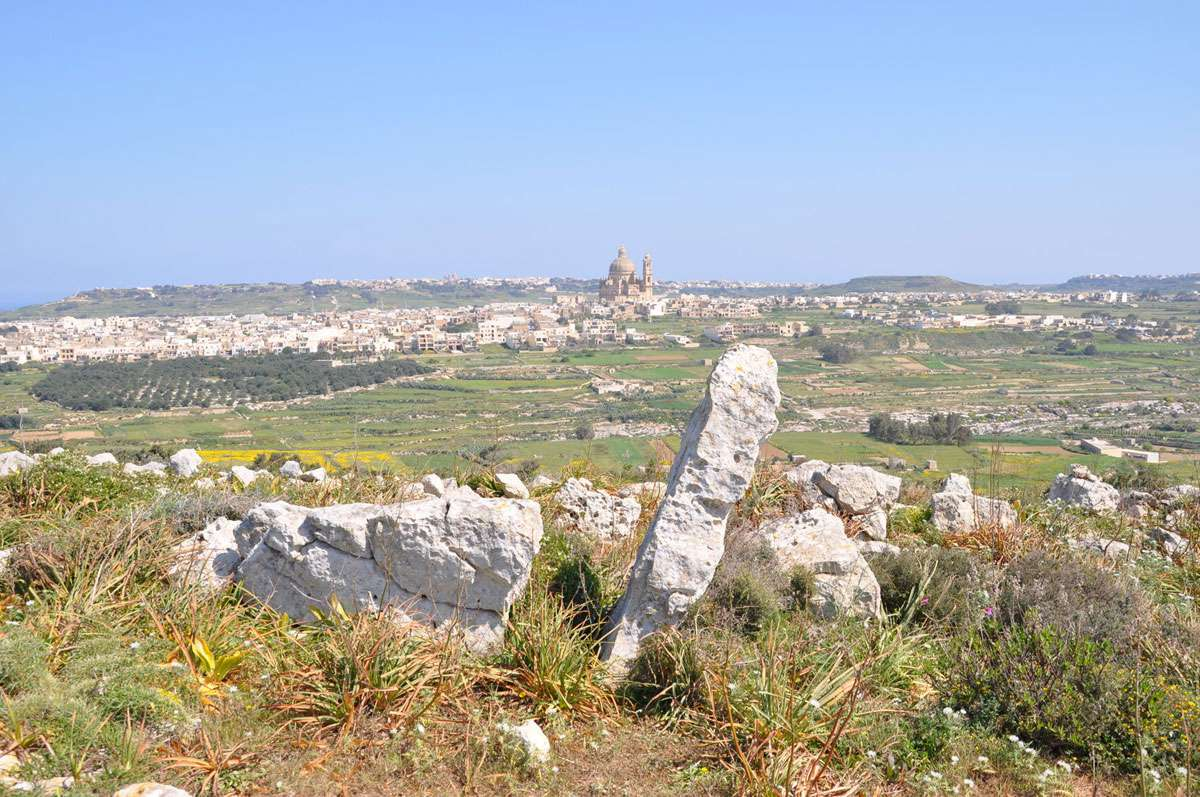 The fields of Gozo are scattered with prehistoric dolmens, Photo: Meg Pier