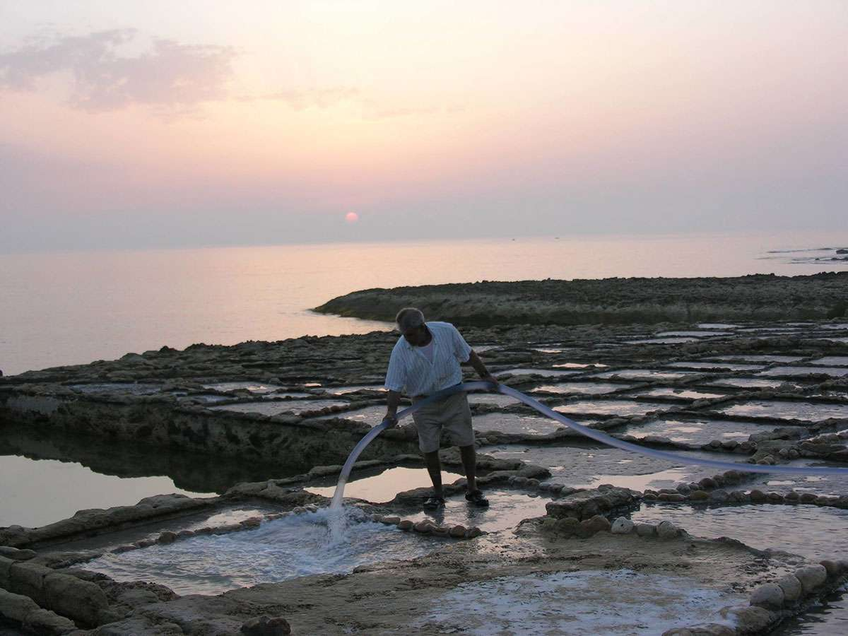 Emmanuel Cini tends his salt pans on the island of Gozo, credit: Emmanuel Cini, Photo: Meg Pier