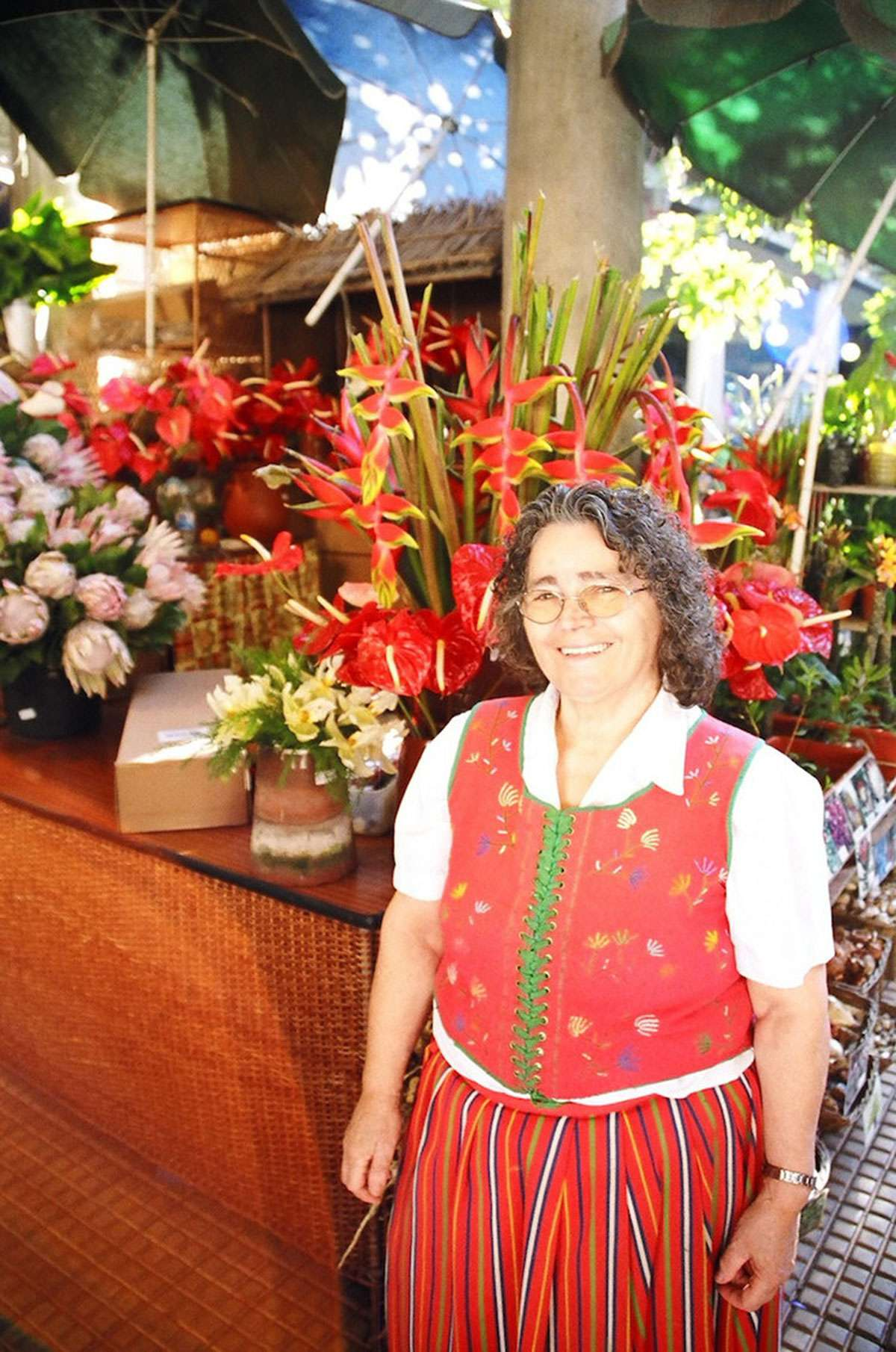 Isabel Pereira sells the flowers she grows at Mercado dos Lavradores in Funchal