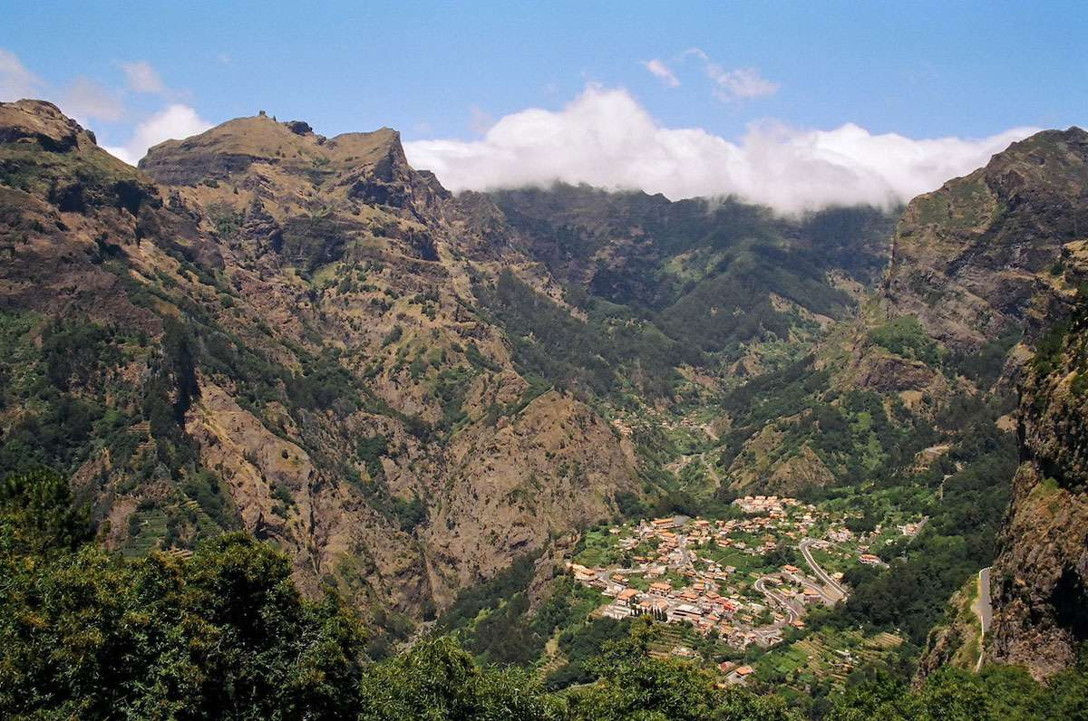 A red-roofed village nestles in Mother Nature's lap in the center of Madeira