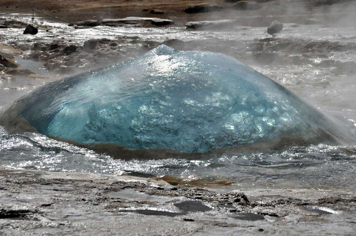 The Icelandic language gives the world the word 'geysir.' This one is named Strokkur--that she blows! Photo: Meg Pier