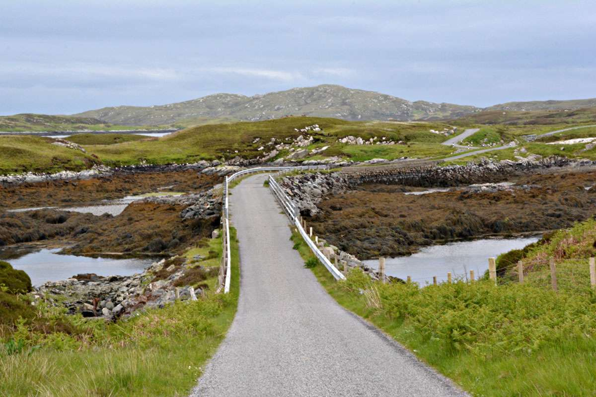 A meandering road through the lowelands and peat bogs of the Isle of Benbecula. Photo: Meg Pier