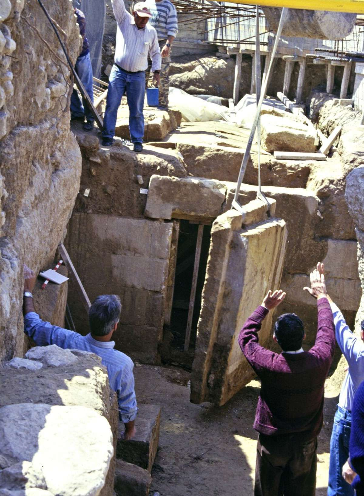 Opening the huge slab door of an intact Phoenician tomb 2750 years after it was last closed at the necropolis of Kition