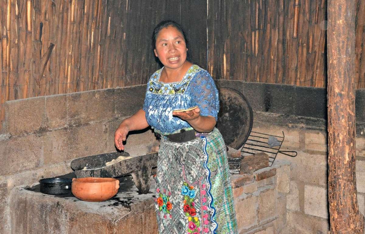 Maria Juana Lopez cooking the tasty tortillas on the griddle. Photo: Meg Pier