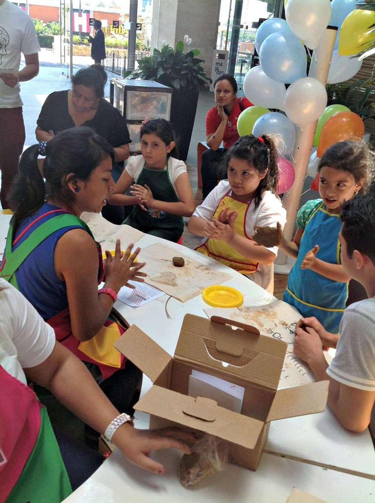 Children in DIDART's workshop with clay pots. Photo: Meg Pier