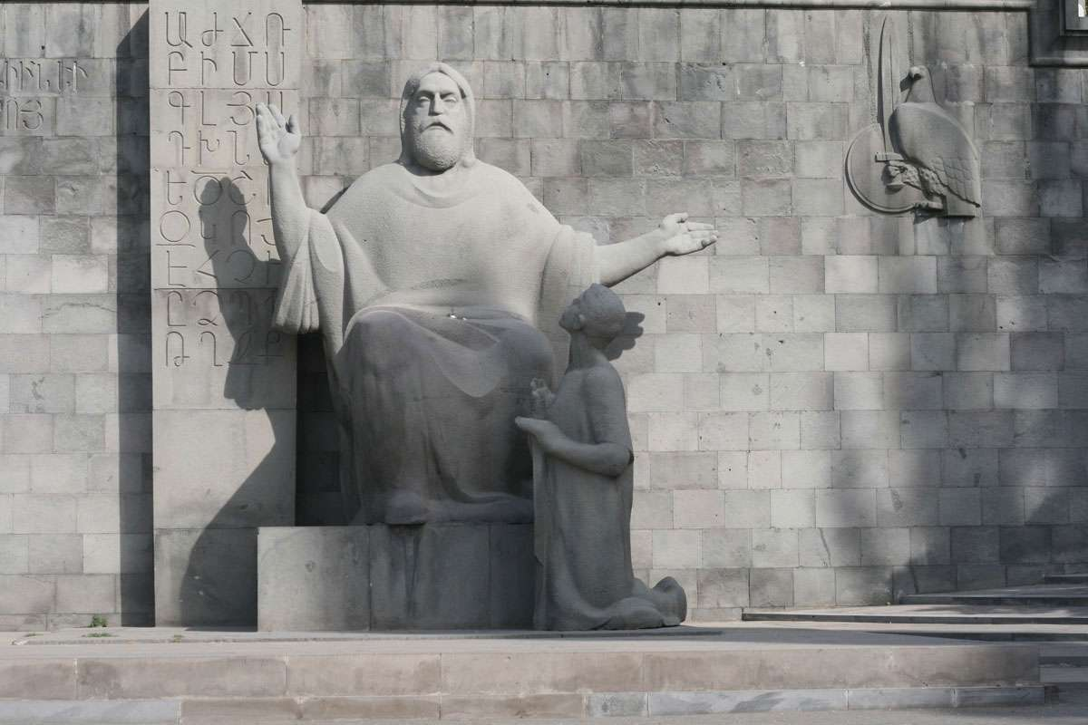 The Matenadaran opened in 1959 and was created on the basis of the collection of manuscripts belonging to Echmiadzin Monastery. In this impressive statue, the scholar is seated with one arm raised aloft, pointing the way to literacy. Photo: Arthur Chapman,  Creative Commons