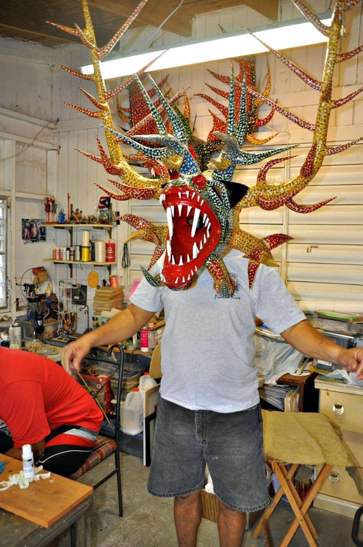 Juan Alindato Junior   shows off one of his creations.   Photo: Meg Pier
