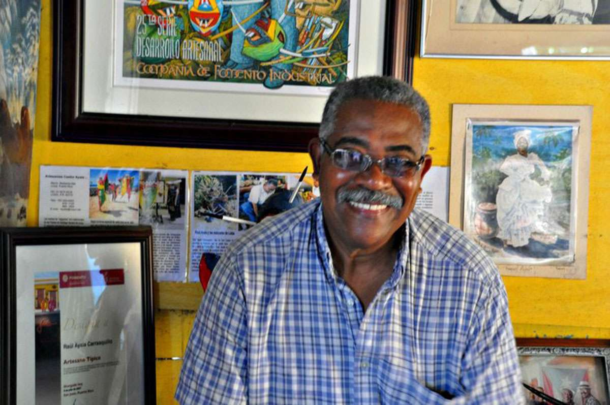 Artisan Raul Ayala of Loiza's masks have a different style and tradition than those of Ponce. Photos: Meg Pier