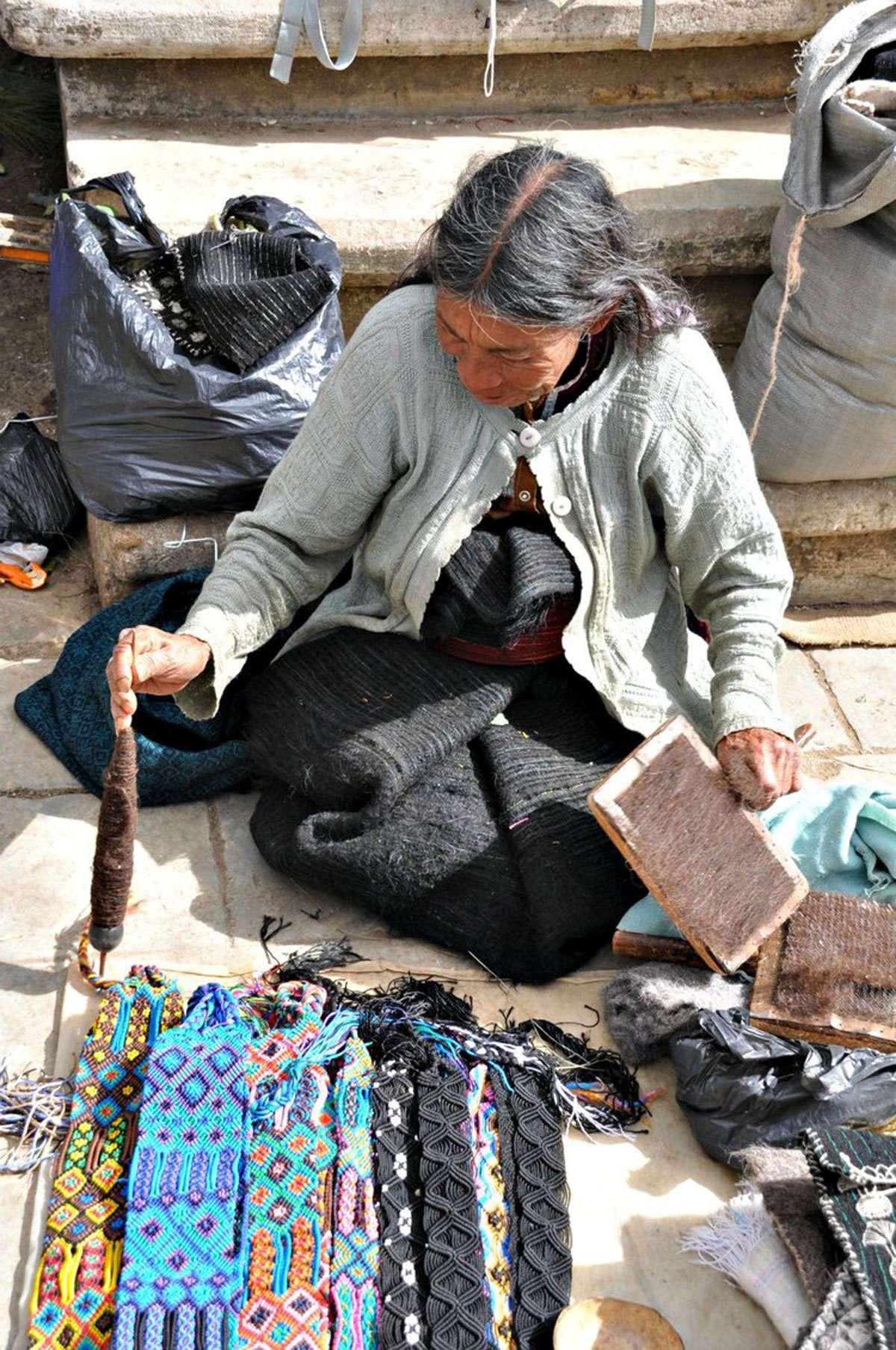 Weaver plies her craft in square of San Juan Chamula. Photo: Meg Pier