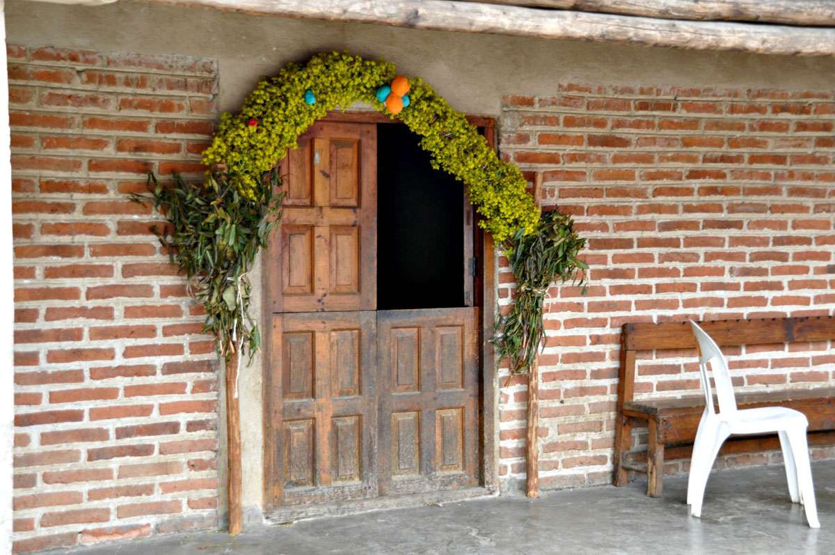In San Juan Chamula, dried yellow flowers signify the home of a spiritual leader. Photo: Meg Pier