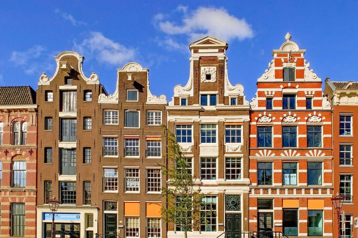 Home exchanger Ana Neto discovered there was an economic reason Amsterdam home owners constructed such tall & narrow buildings.
