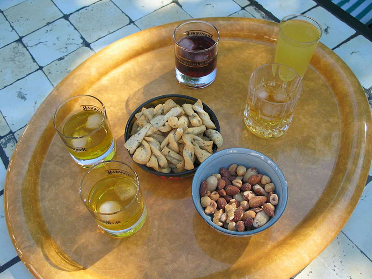 """Apéritif is a French word derived from the Latin verb aperire, which means """"to open""""; the custom is designed to stimulate the appetite. Photo: DocteurCosmos, Creative Commons"""