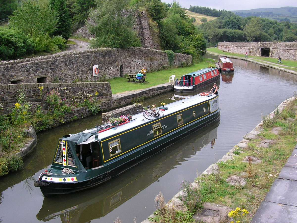 An English narrowboat navigates one of the tightly-constructed channels. Photo: Roger W Haworth, Creative Commons