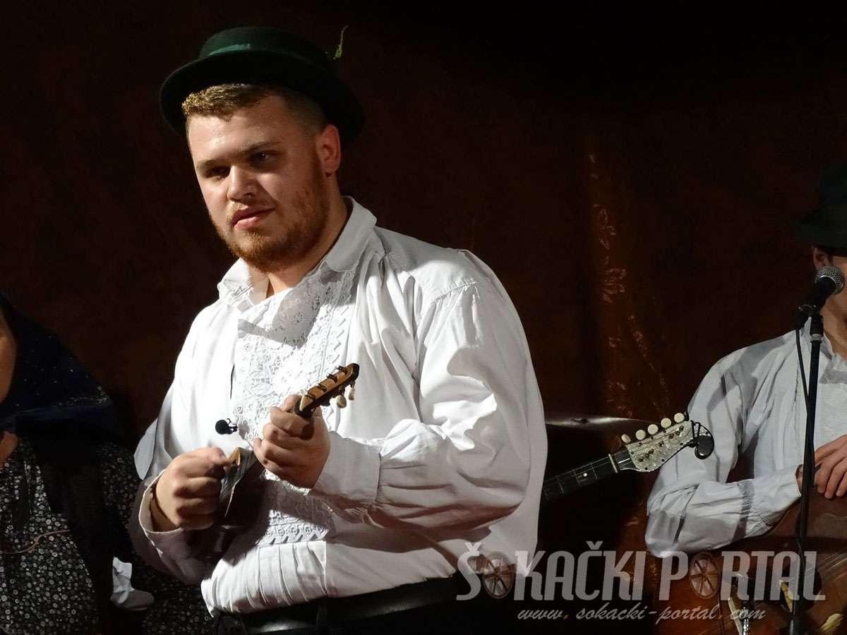 Matej Vinarić playing tambura in the Bicko Selo orchestra.