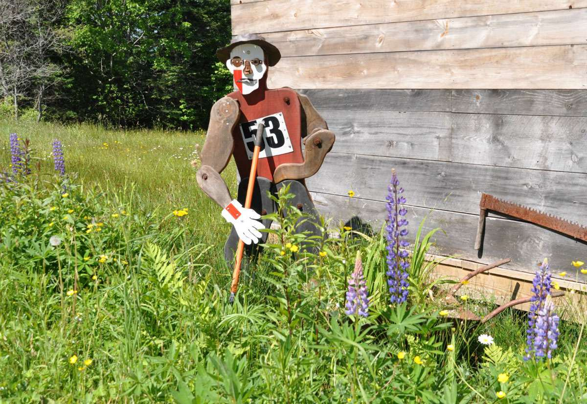 This whimsical sculpture among the lupines welcomes visitors. Photo: Meg Pier