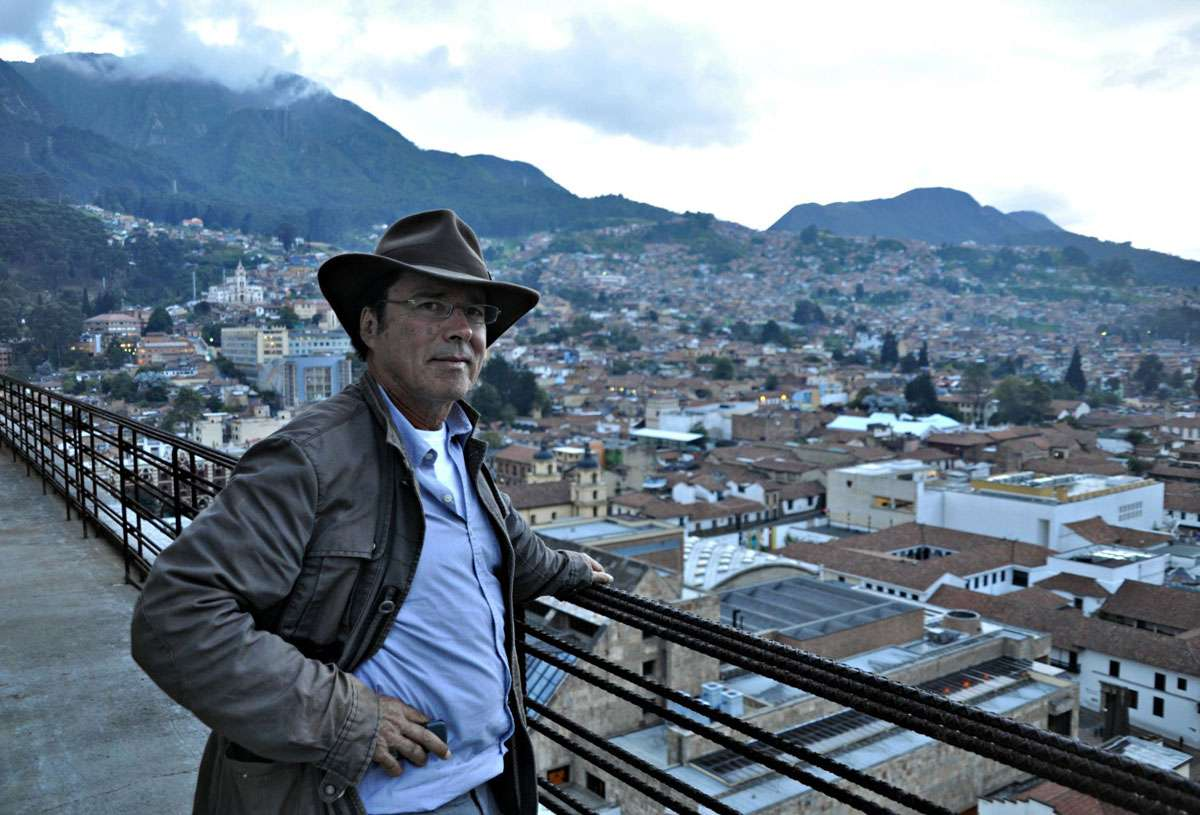 Simon Velez on the balcony of a Bogota apartment he renovated. Credit: Meg Pier