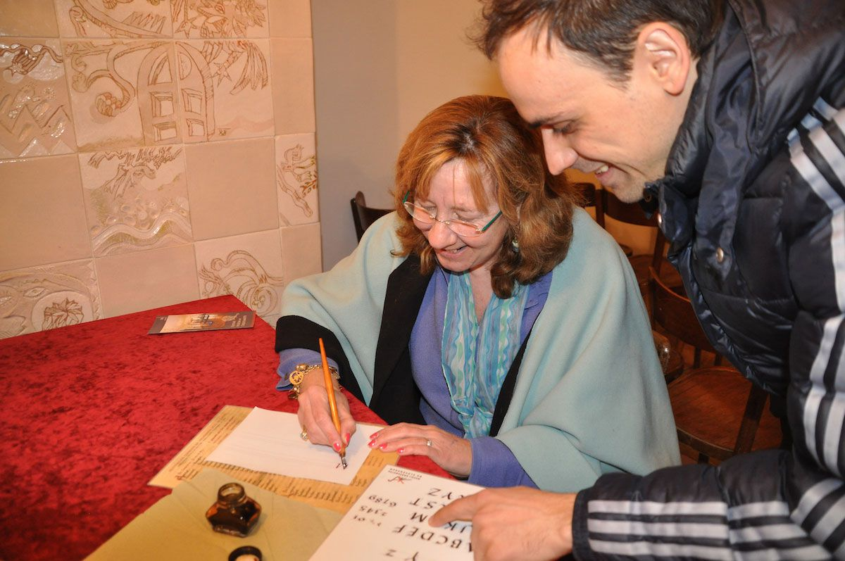 A lesson in calligraphy at Slovenia's Sticna Abbey. Photo: Meg Pier
