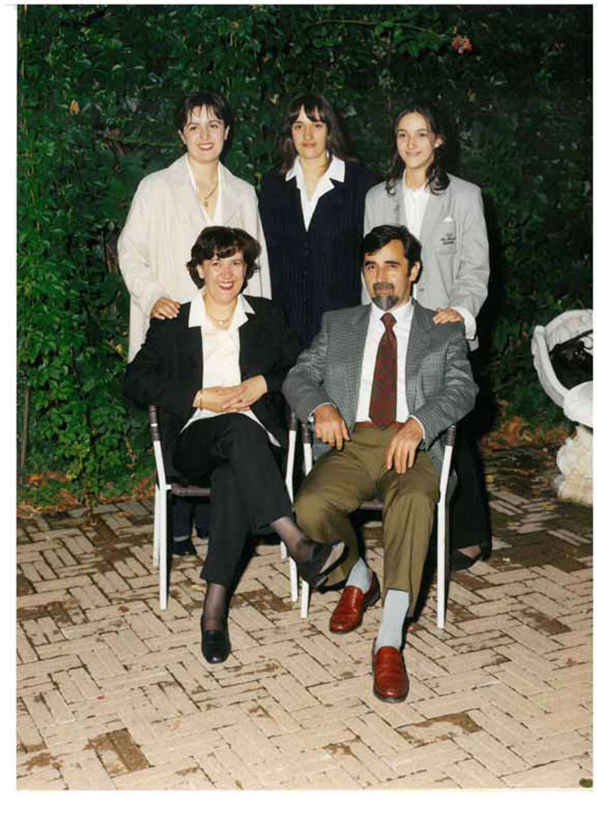 Michela Conti with her family. With her mother and sisters, she is carrying on the business her father founded.