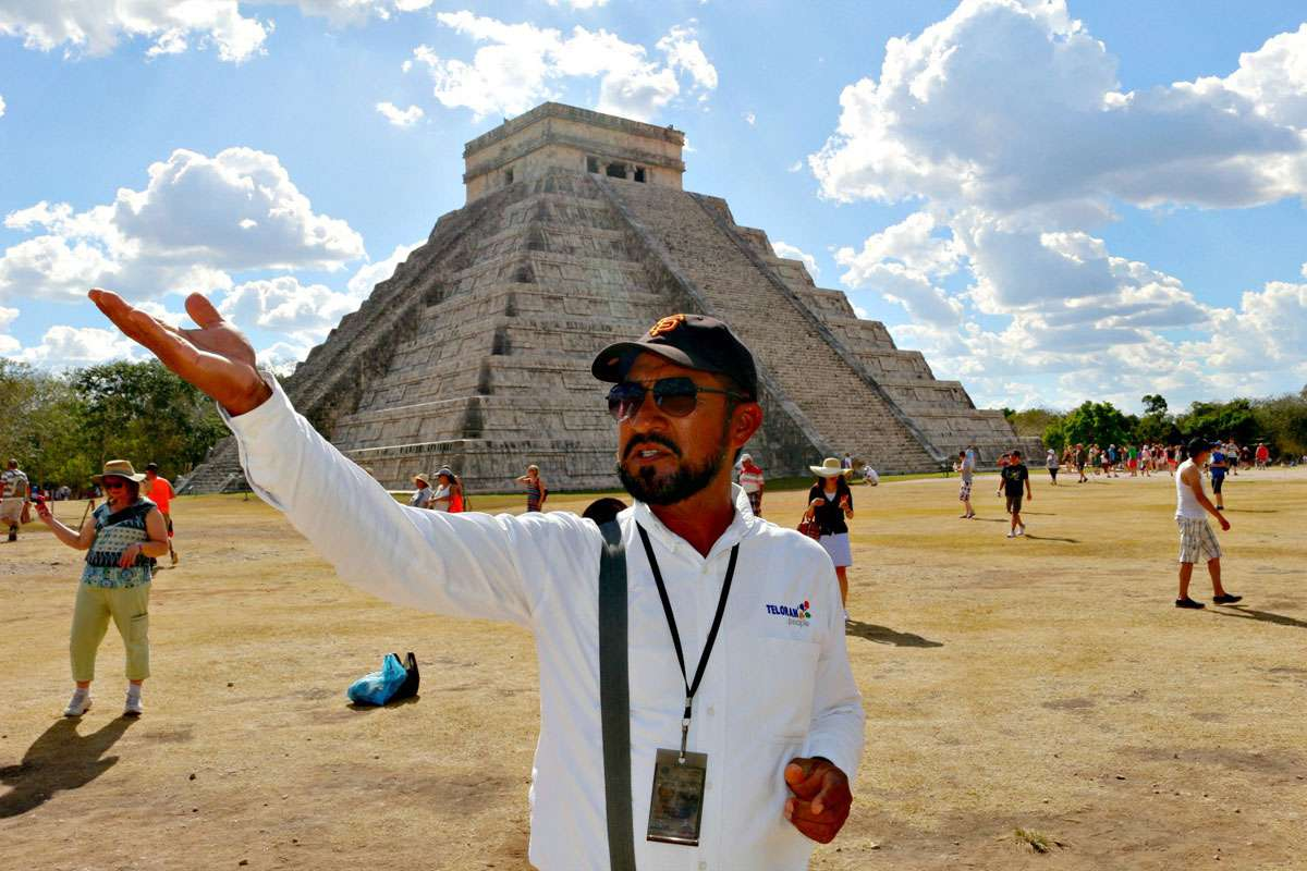 Guide Julian Briceno Carrilo offers insights into the history of Chichén Itzá, declared one of the world's 'Seven Wonders'! Photo: Meg Pier