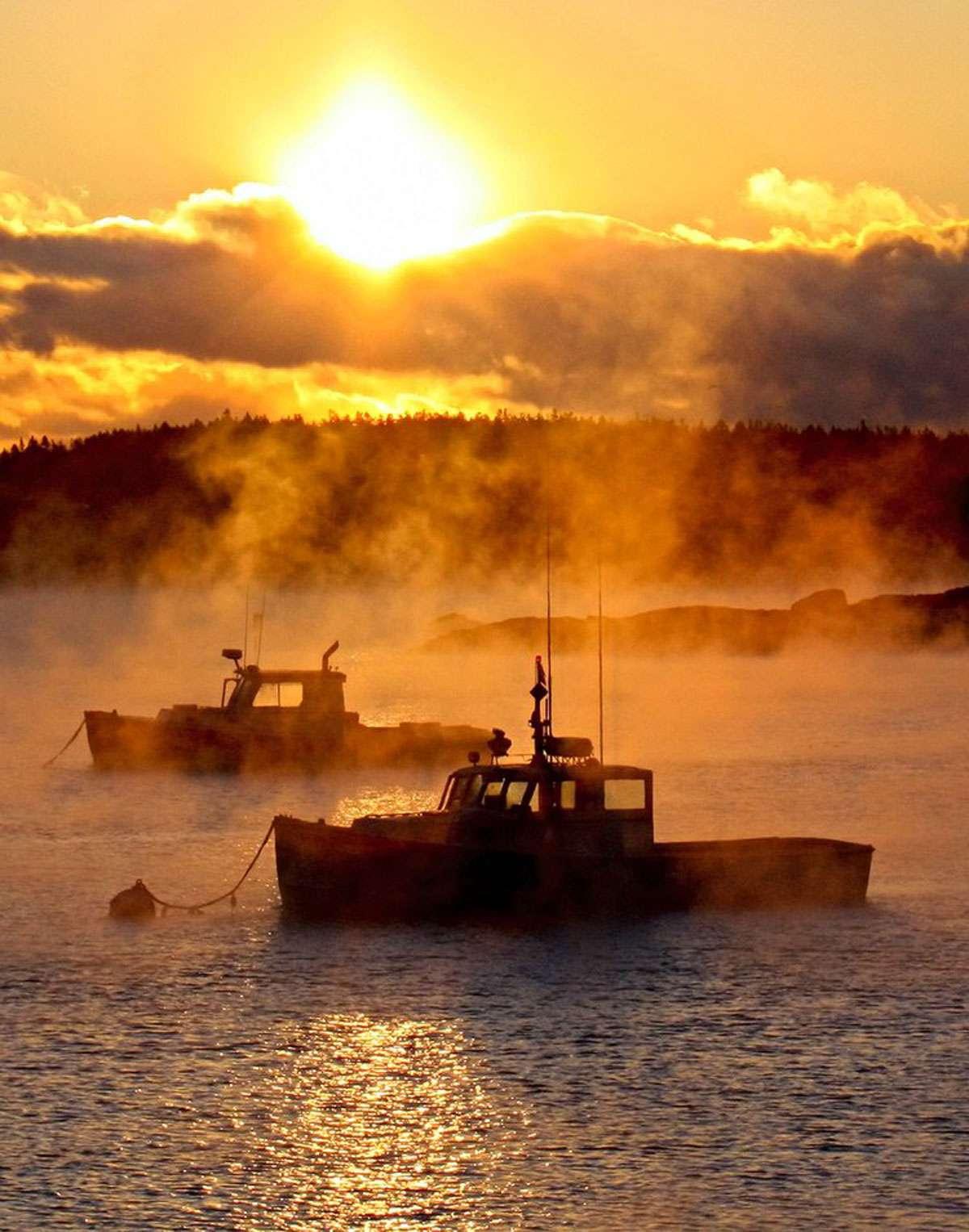 Sunrise & arctic vapor with two boats. Photo: Julie Eaton
