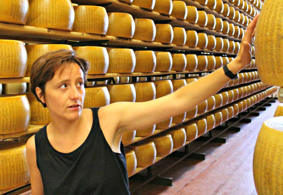 Third-generation artisanal cheese-maker Serena Peveri explains the purpose of the markings on the cheese