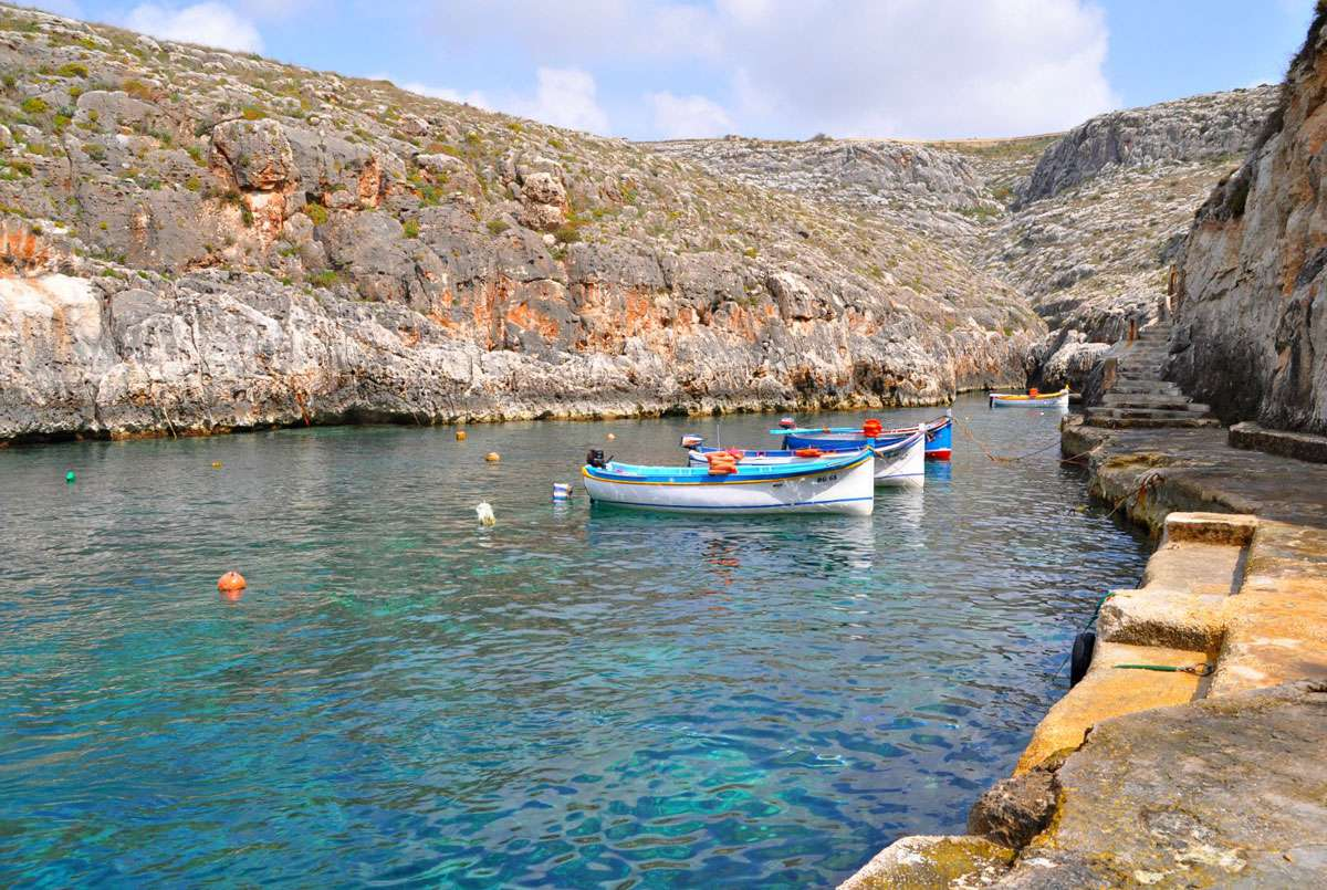 The narrow bay that is home to the frigatina boats that bring visitors to Malta's Blue Grotto