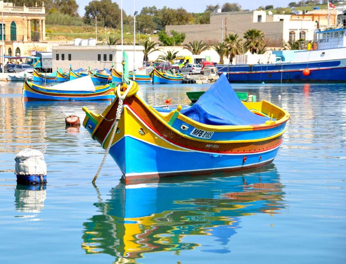 Colorful luzzu fishing boats make Marsaxlokk Bay in Malta a must-see