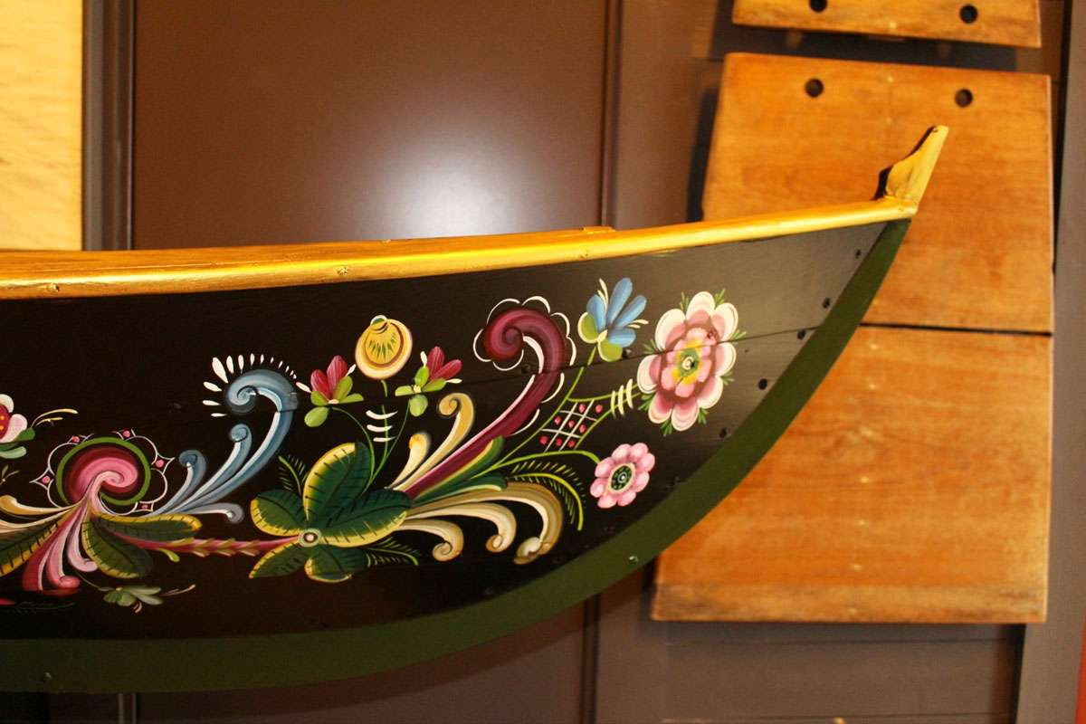 Contemporary musicians are hip to traditions & Rosemaling tradition; Torunn was asked to decorate a traditional Oselvar boat for the area's annual Osfest. Photo: Meg Pier