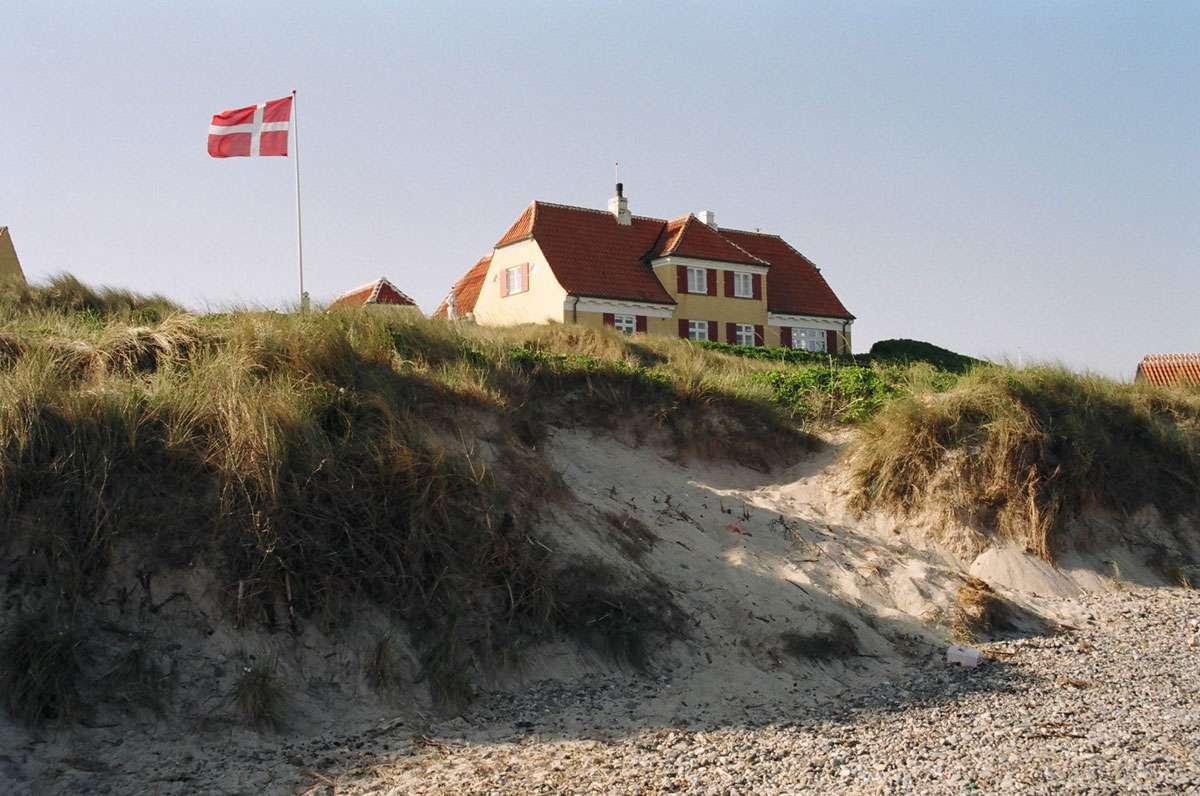 A Gammel Stan home in Skagen yellow sits atop the dunes. Photo: Meg Pier