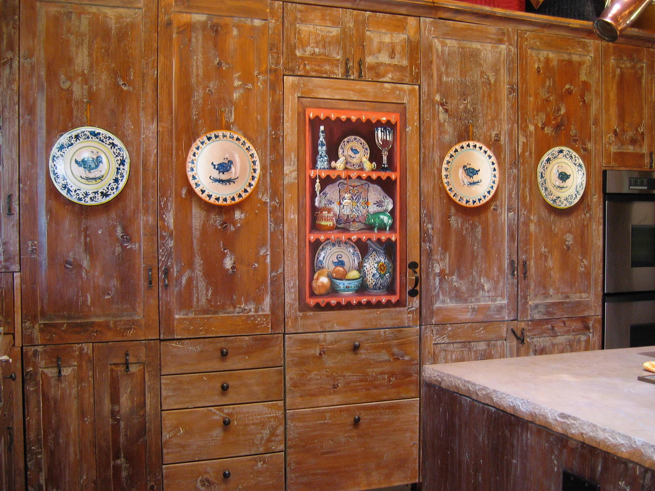 Trompe l'oeil plates and shelves with objects, painted on cupboard doors