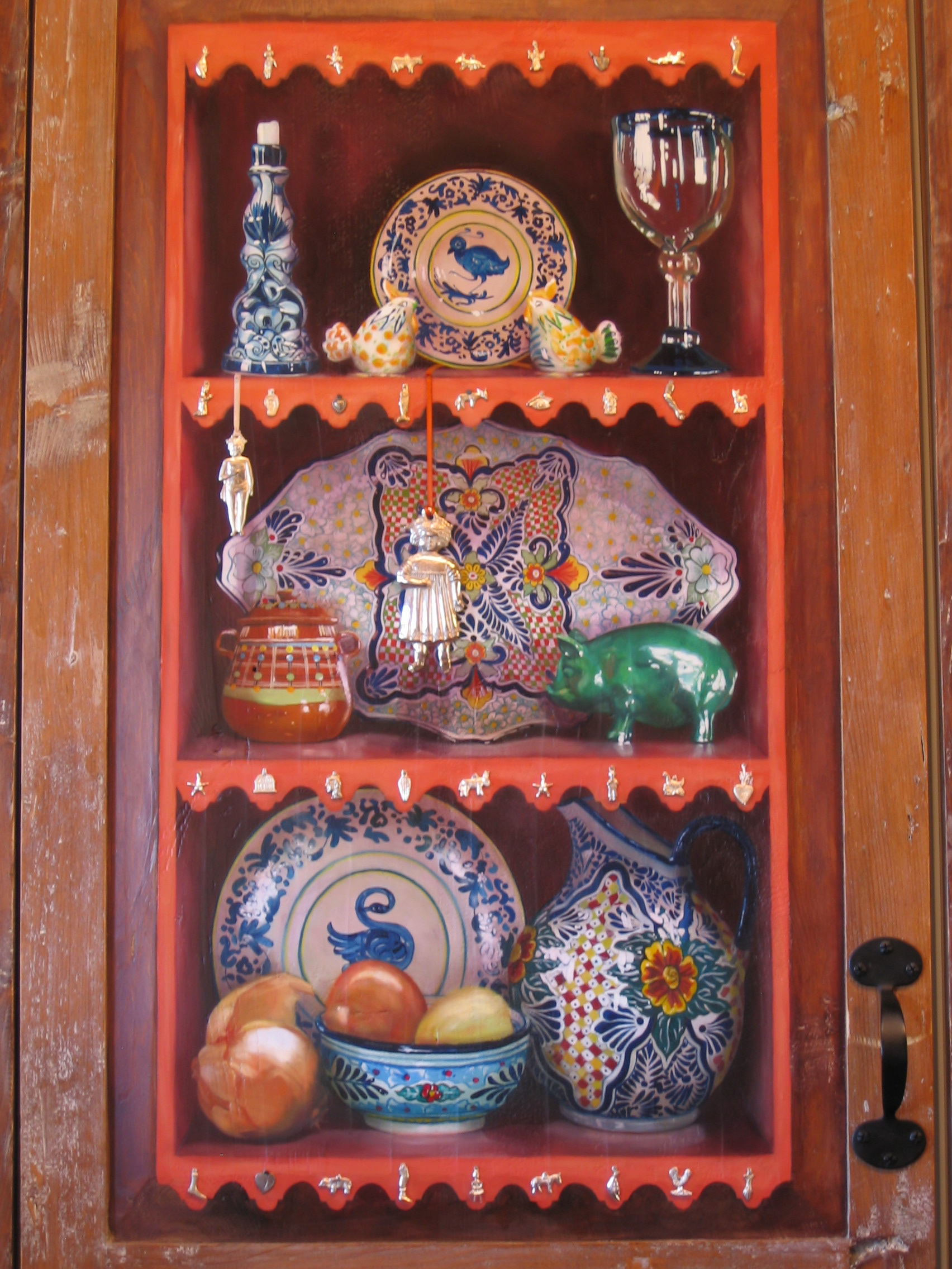 Trompe l'oeil shelves and objects painted on wooden cupboard