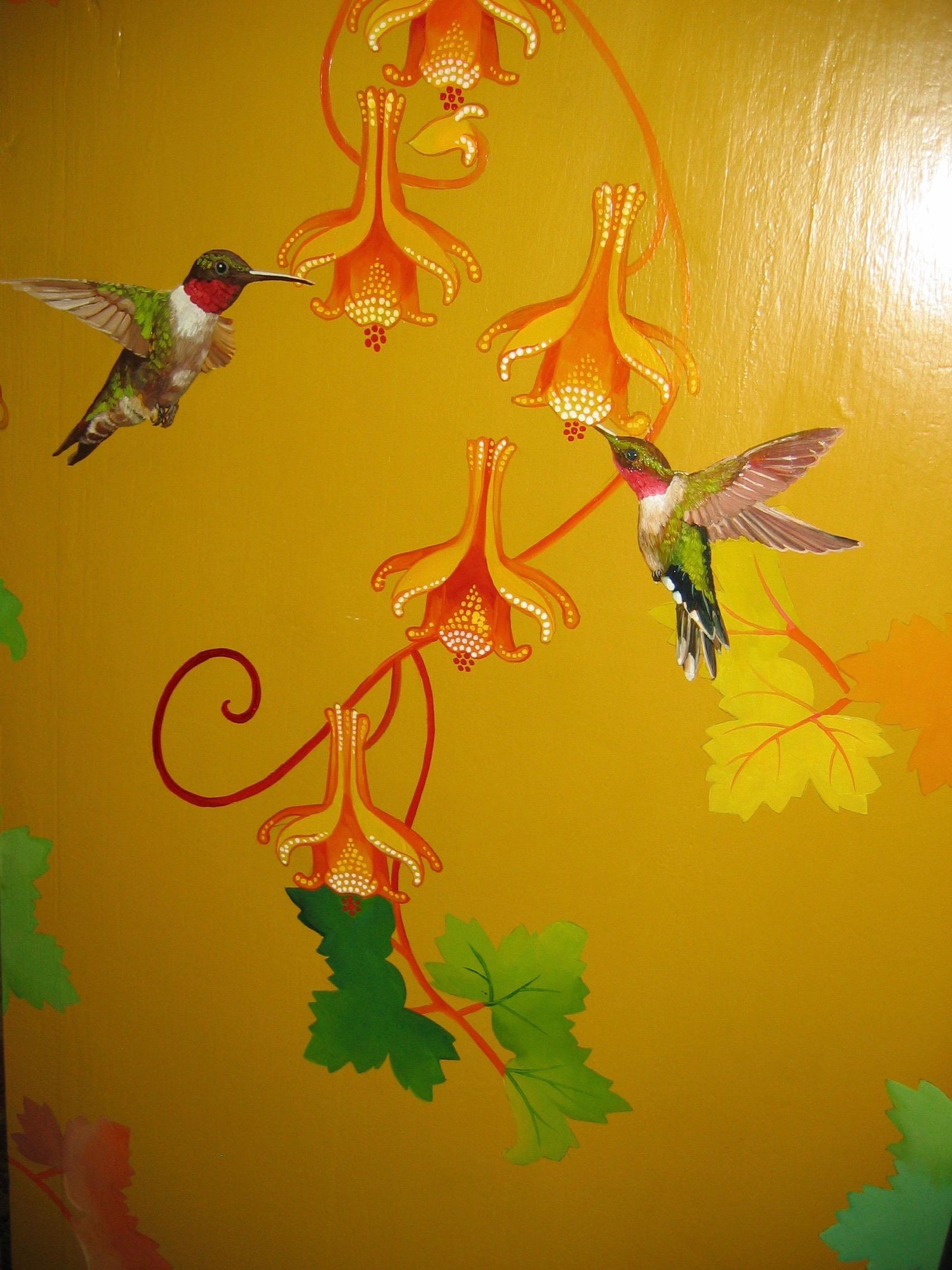 hummingbird detail on cabinet