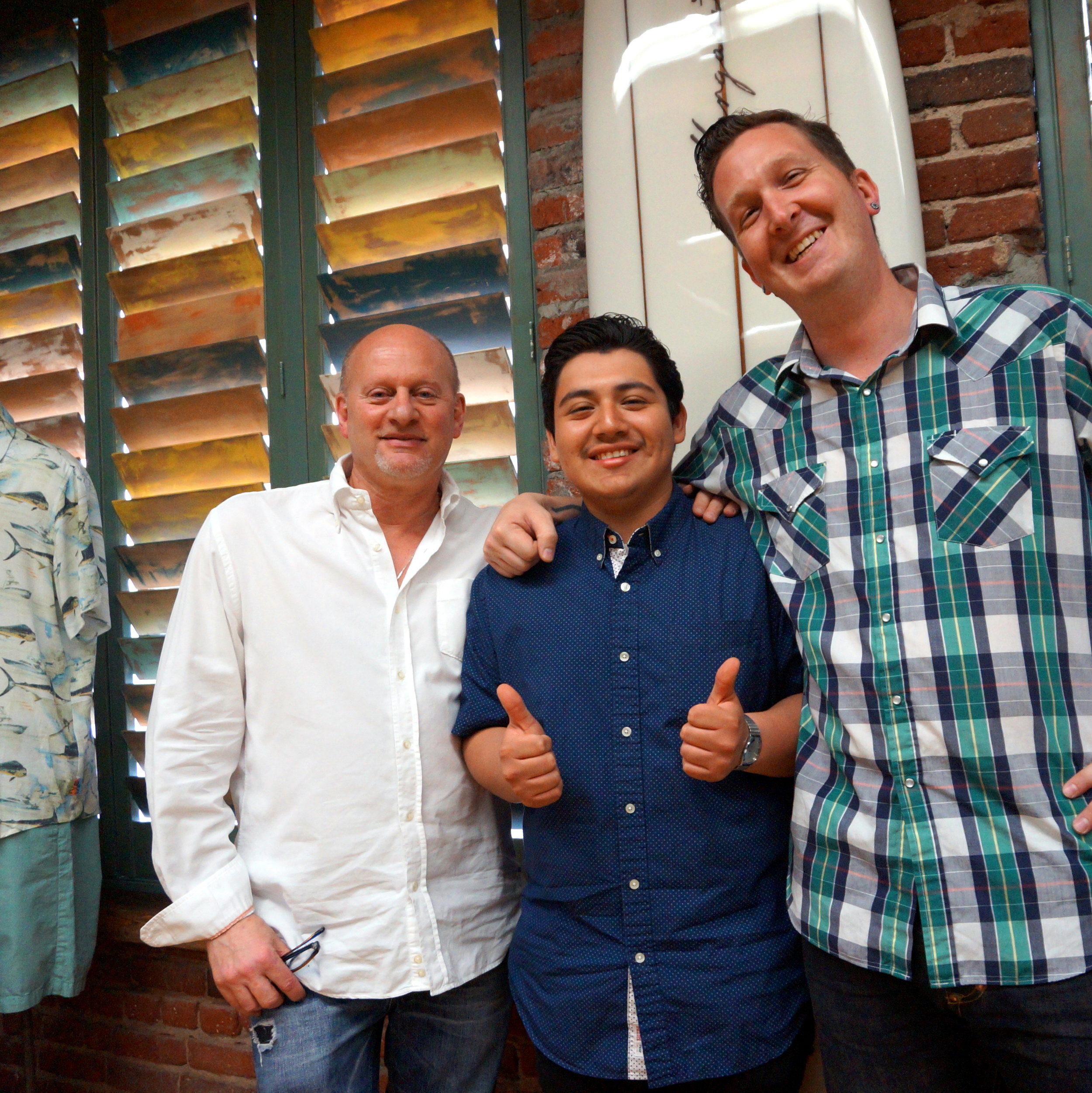 Julian, an ETA Intern in fashion & graphic design, with his mentors at Margaritaville Apparel.