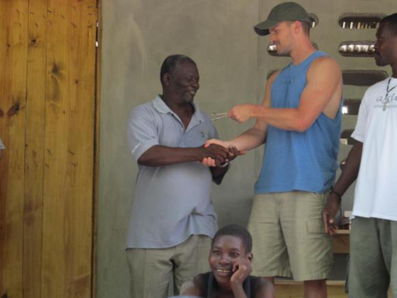 Providing the keys to the school to Jean Claude, the school director and church pastor.