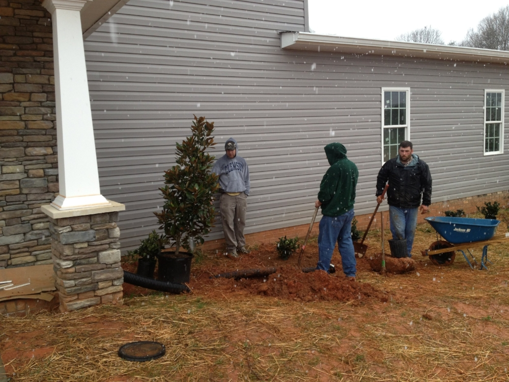 Many volunteers were used in building Sandra's Home. Here is Putnam Baptist Church men's group planting trees and shrubs.