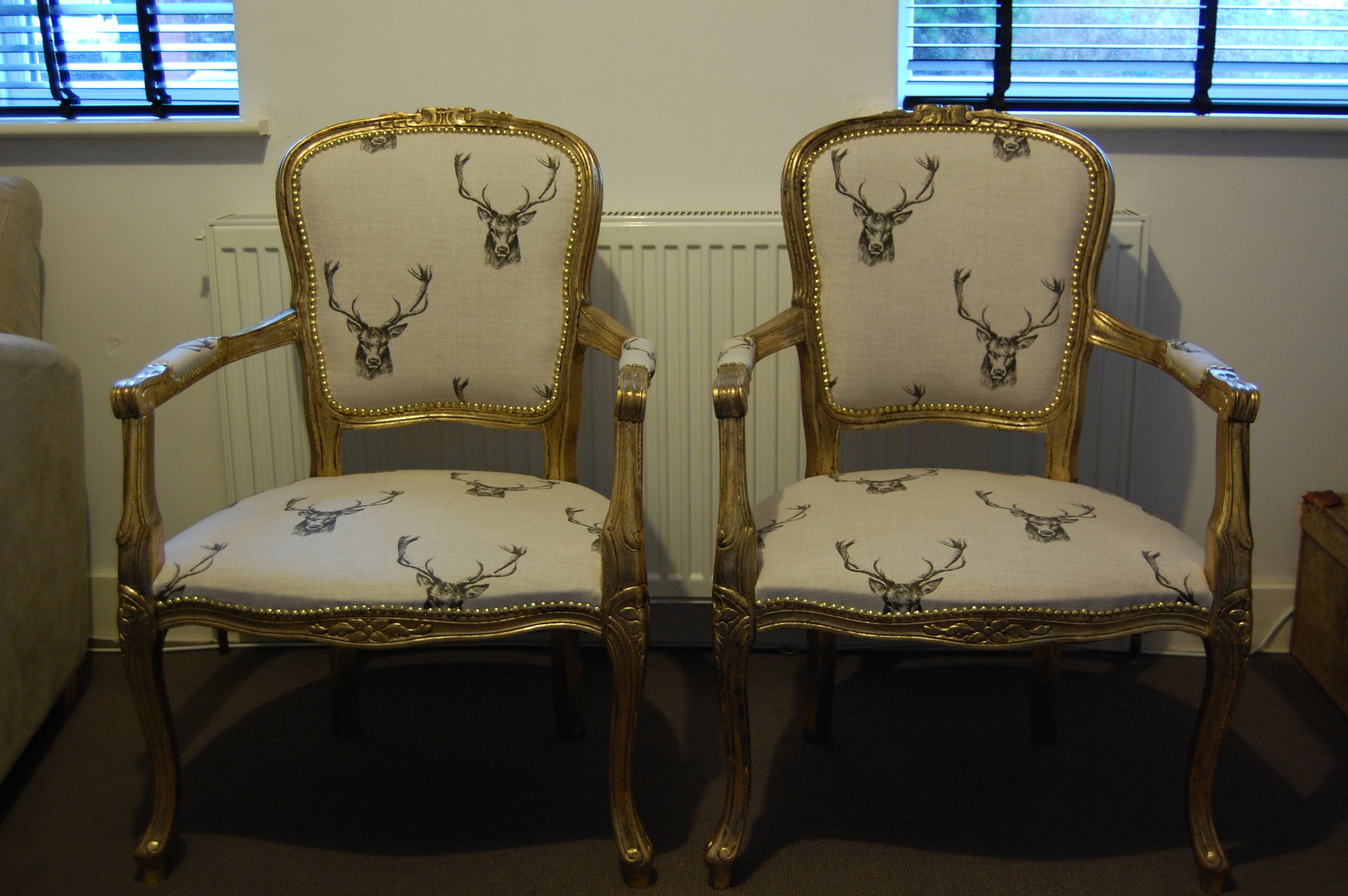 Grist & Twine Upholstery: Pair of reproduction salon chairs reupholstered in stag print fabric