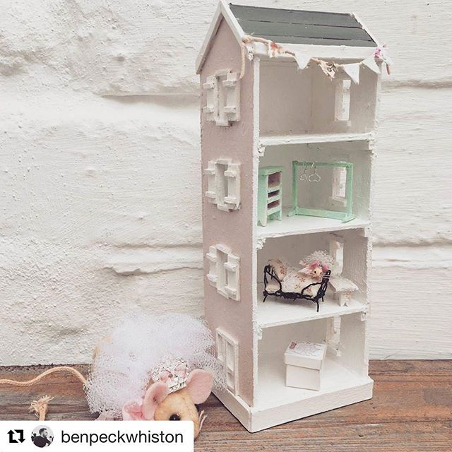 """I don't know when I've been so completely speechless! @benpeckwhiston has created a miniature of Lula Kate and Eliza's dollhouse """"Pink House"""" as a gift for Lula Kate ...along with a tiny tiny #elizathemouse™  We can't wait for it to arrive here at Rose Water Cottage! There will be much squealing! Thank you Ben, for sharing your artistry..your incredible gift, with the world. You are a treasure, indeed! 🌸🐭👧🏻🌸💫💫 #tinytreasures #miniatures #miniatureofaminiature #lulakatemeetseliza #dollhouse #pinkhouse #toyphotography #livethelittlethings #creativepreneur #childrensbooks #storybookcharacter @benpeckwhiston @jensearthangels #earthangelstudiosdotcom #benpeckwhiston #handmade #handstitched #shabbychic"""