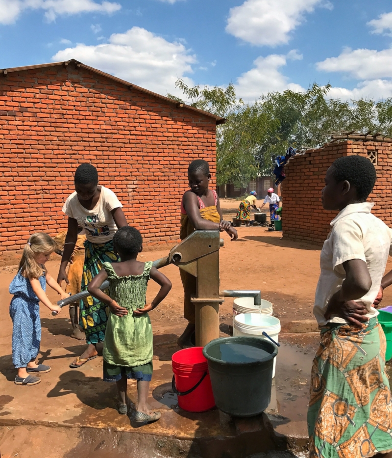 """Helping out in the village during our stay at """"Hope Missions"""", Malawi"""