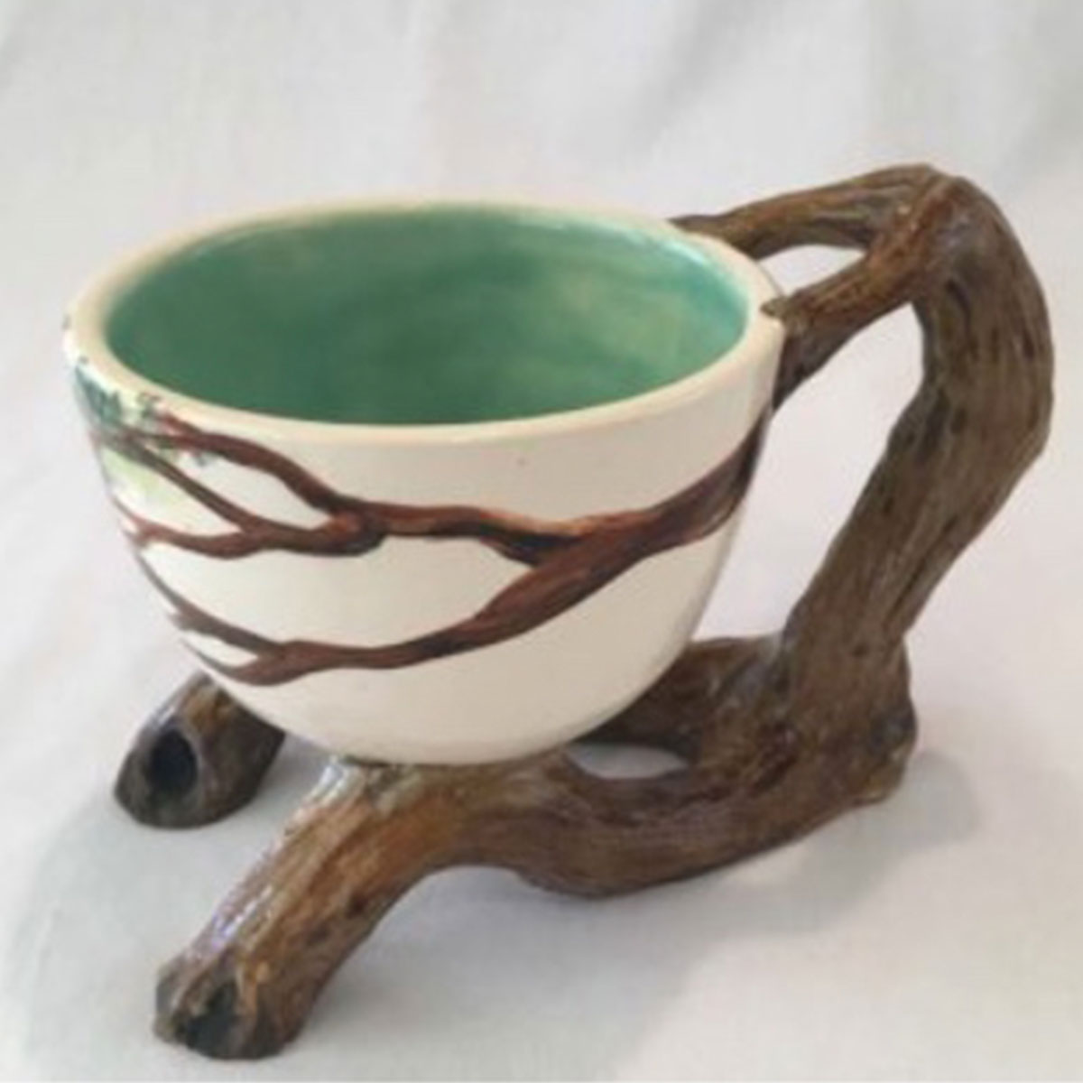 Awd Dog Studios - Knotty Wares are functional sculpture. Have your tea in a tree.