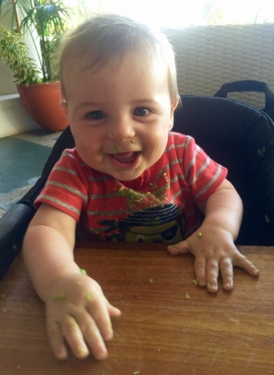 Theo's joyous first food experience - avocado in Hawaii