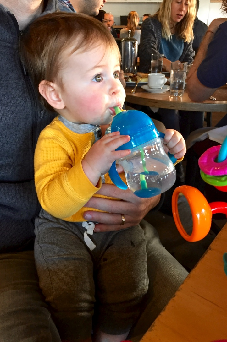 Theo drinking water from his  Munchkin straw cup at one of our favorite restaurants