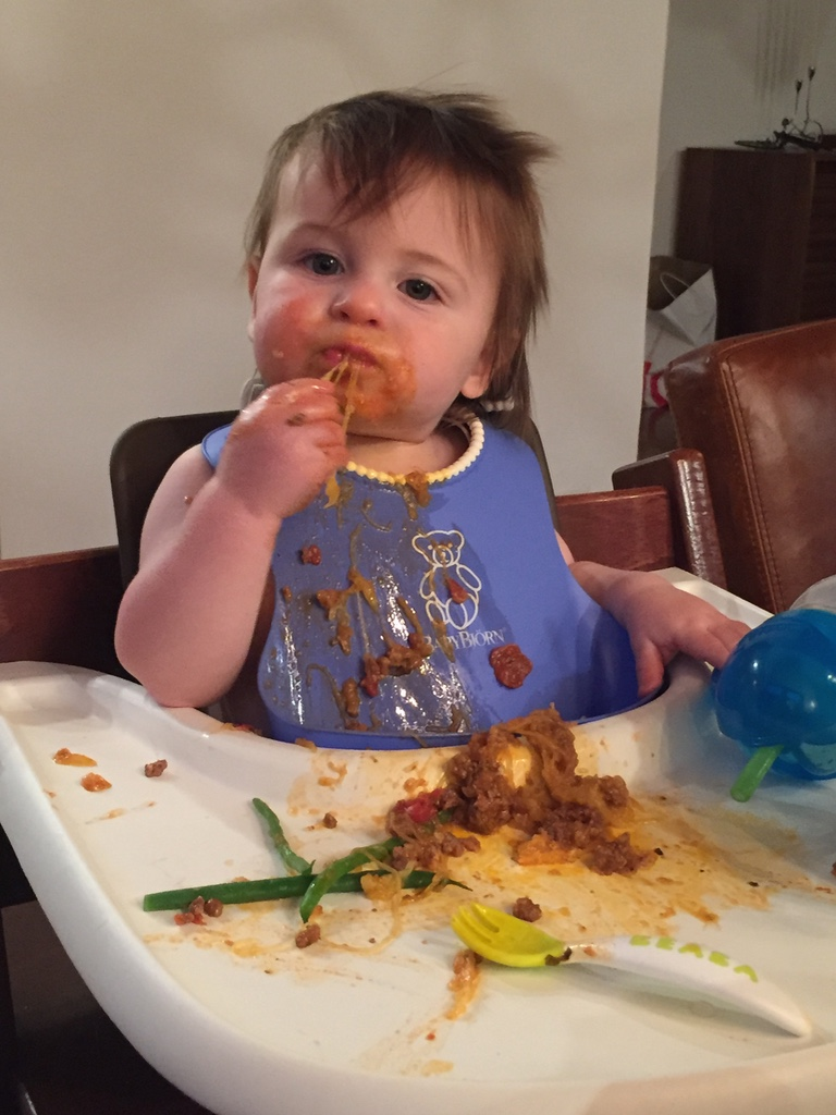 Theo eating another variation of spaghetti squash with Bolognese, made only with ground beef and some light tomato sauce