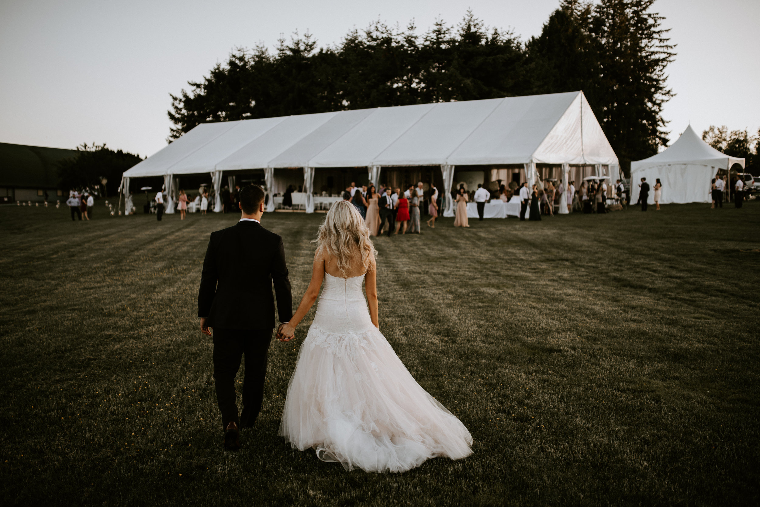 Bride and Groom entering their wedding reception at Mount Lehman Winery in Abbotsford