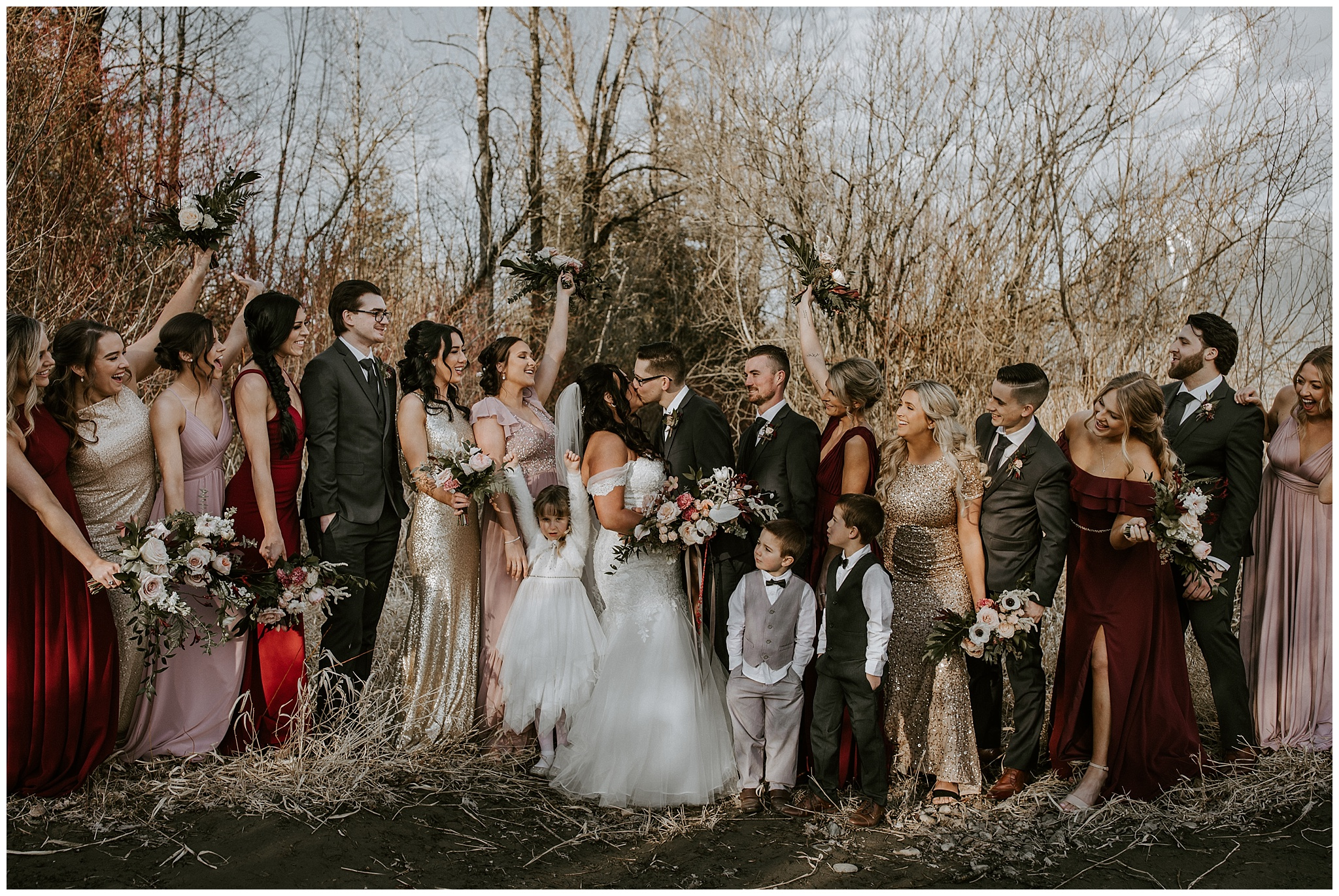 A big bridal party photo outside of the Fraser River Lodge