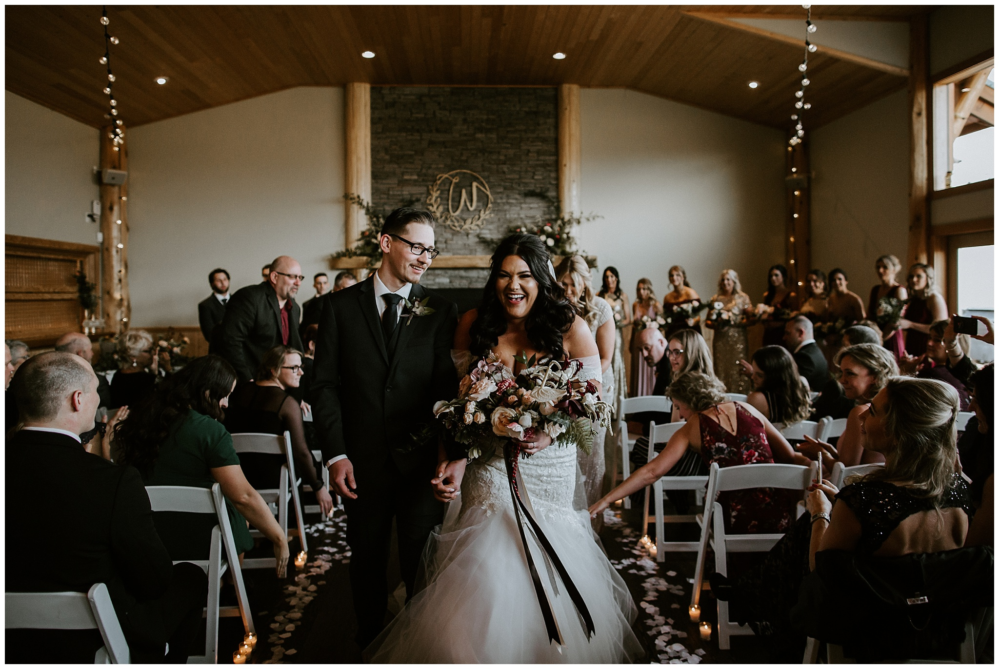 Wedding ceremony in front of the fireplace at the Fraser River Lodge.
