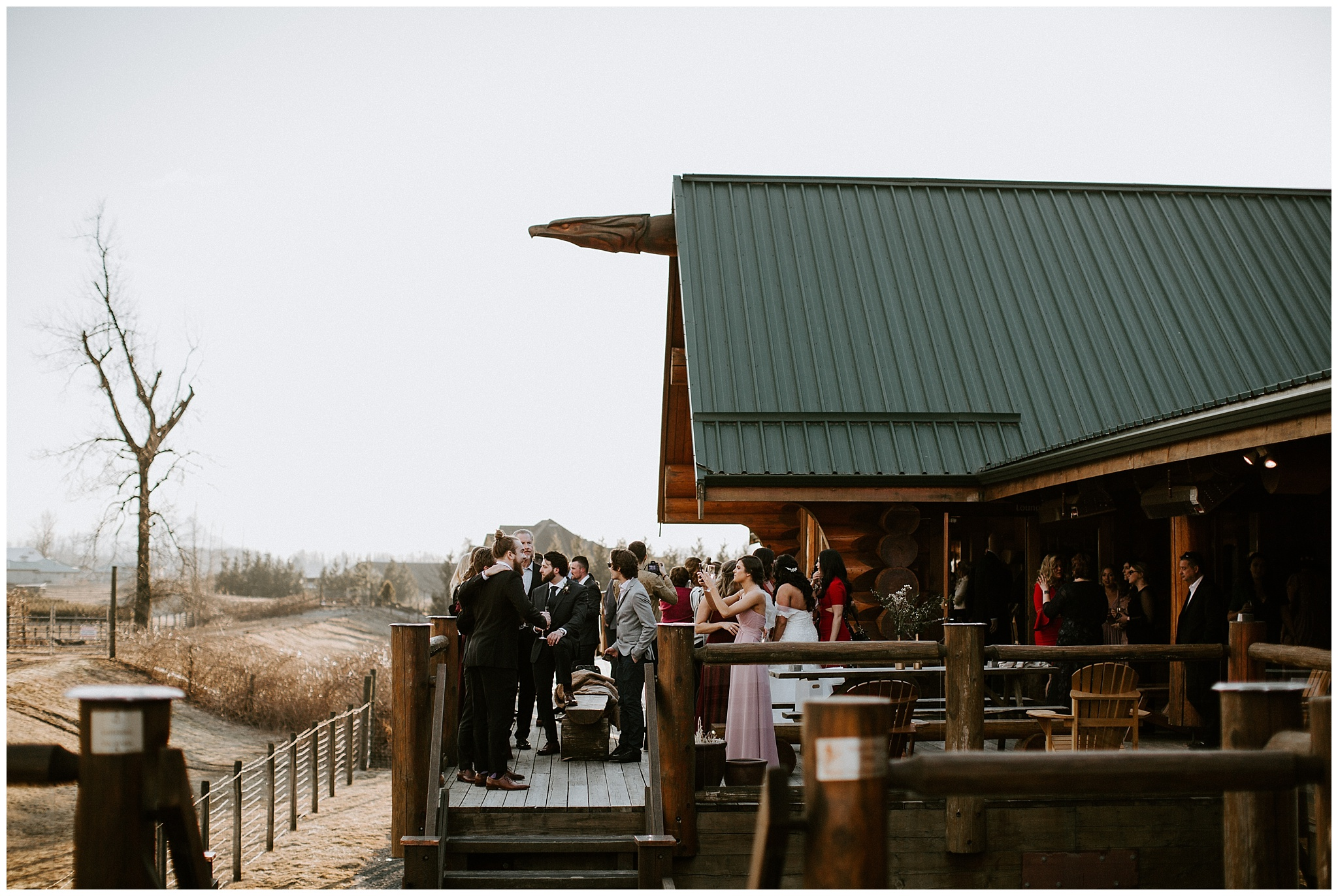 Wedding guests on the deck at the Fraser River Lodge.
