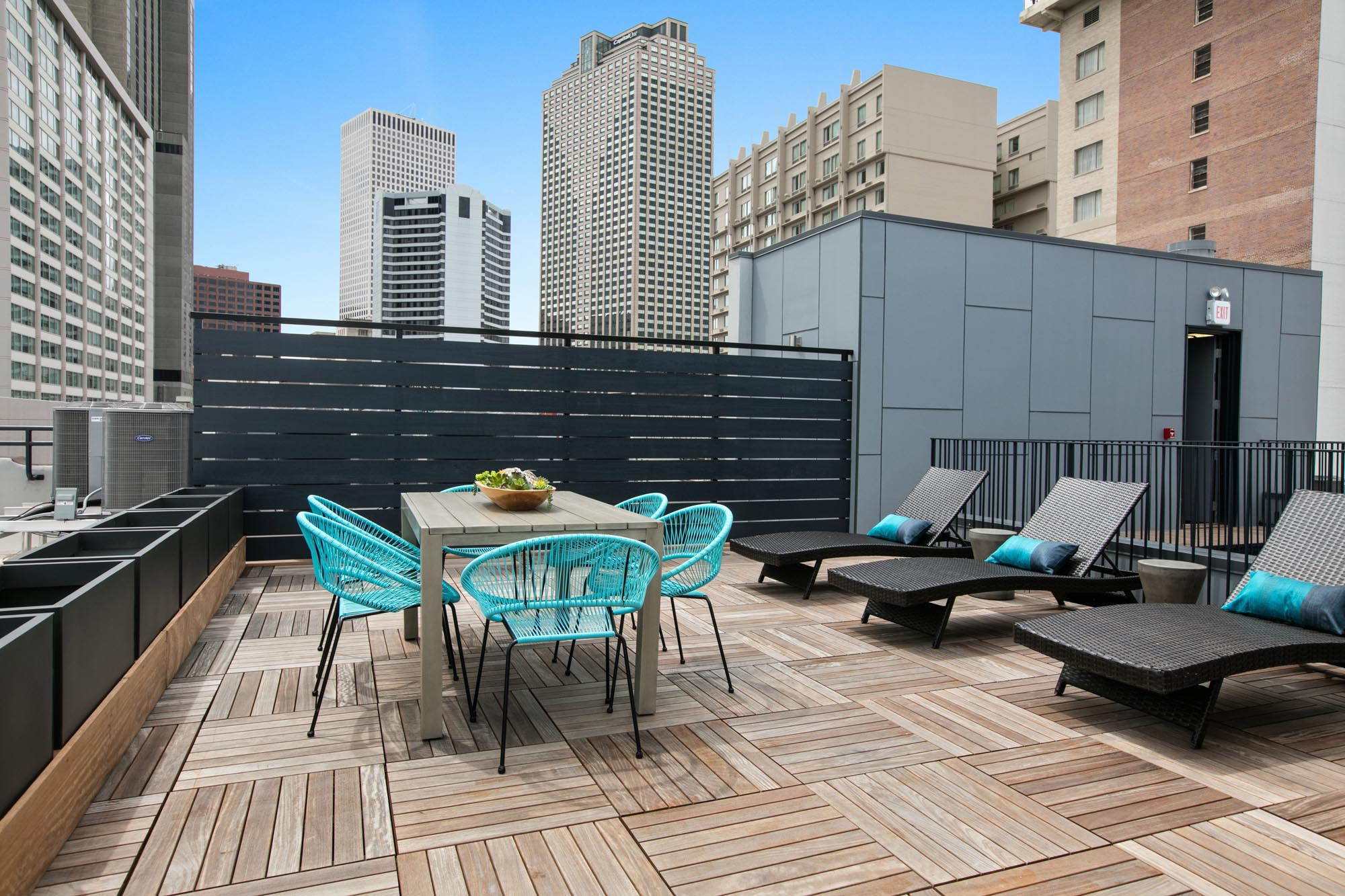 Large rooftop space with wicker beach chairs